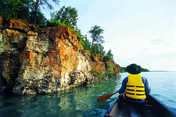 Paddle through the rock caves at Caddy Lake.