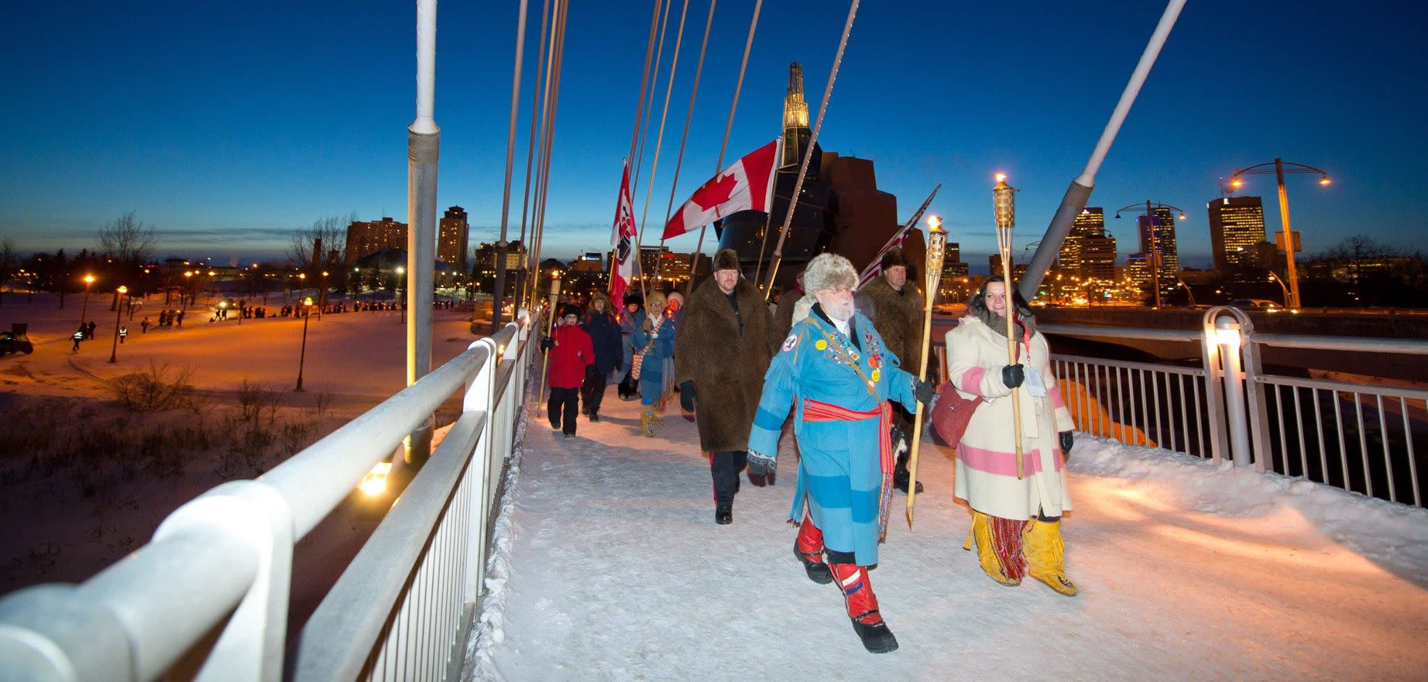 Torch light walk from Canadian Museum for Human Rights to Voyageur Park .