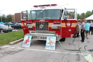The fire truck is big and shiny - perfect for exploring!