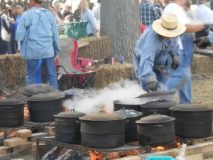 Mmm - smell the food cooking? These chefs use open fires and Dutch ovens to produce delectable dishes in the pioneer style.
