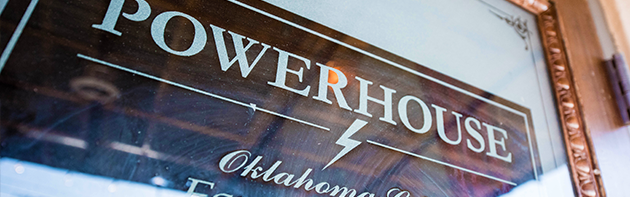 """Image of a sign that says """"POWERHOUSE"""" Which is describing the restaurant PowerHouse in the Farmer's Market District in Oklahoma City, Oklahoma"""