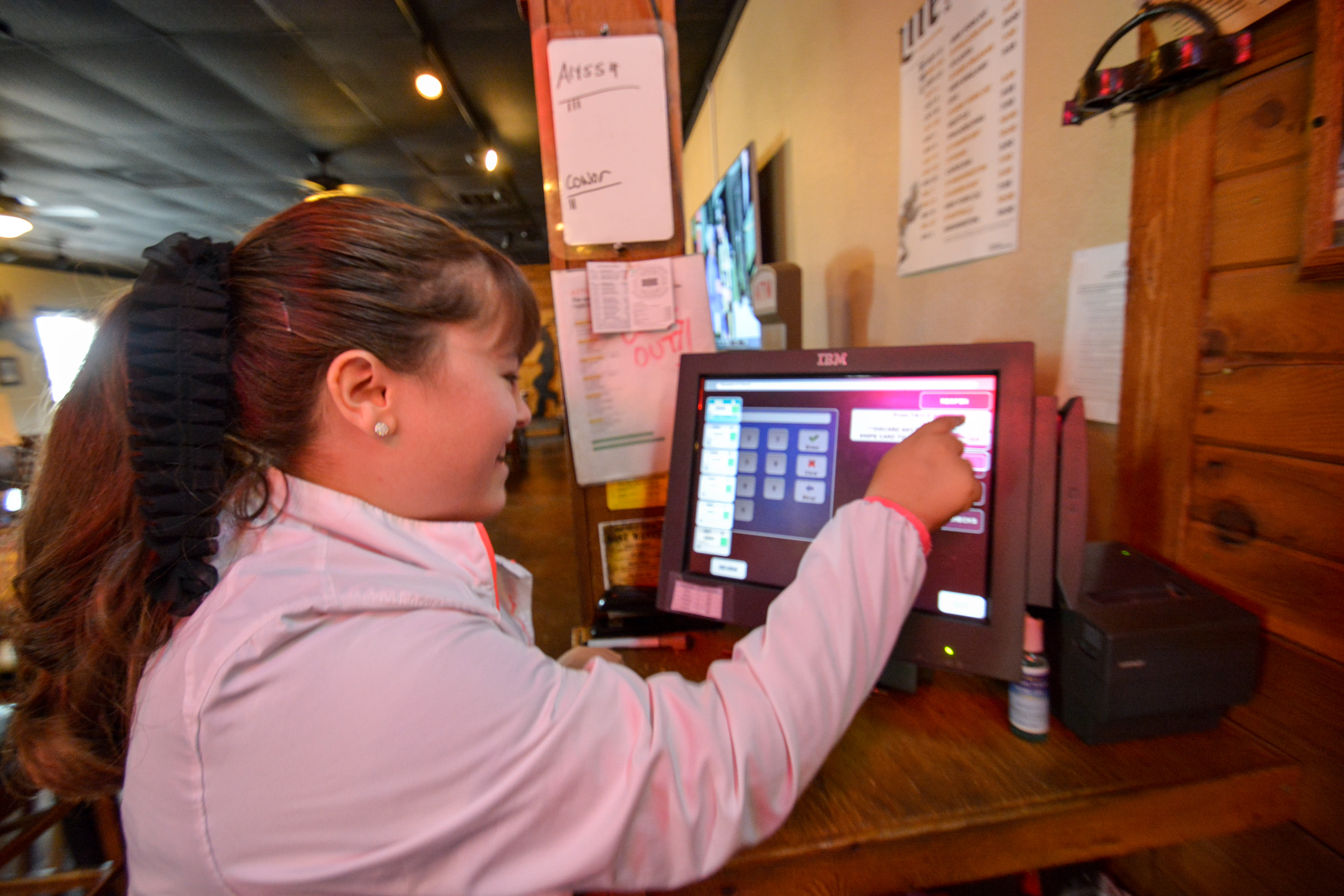 Alyssa adding orders into the point of sale system