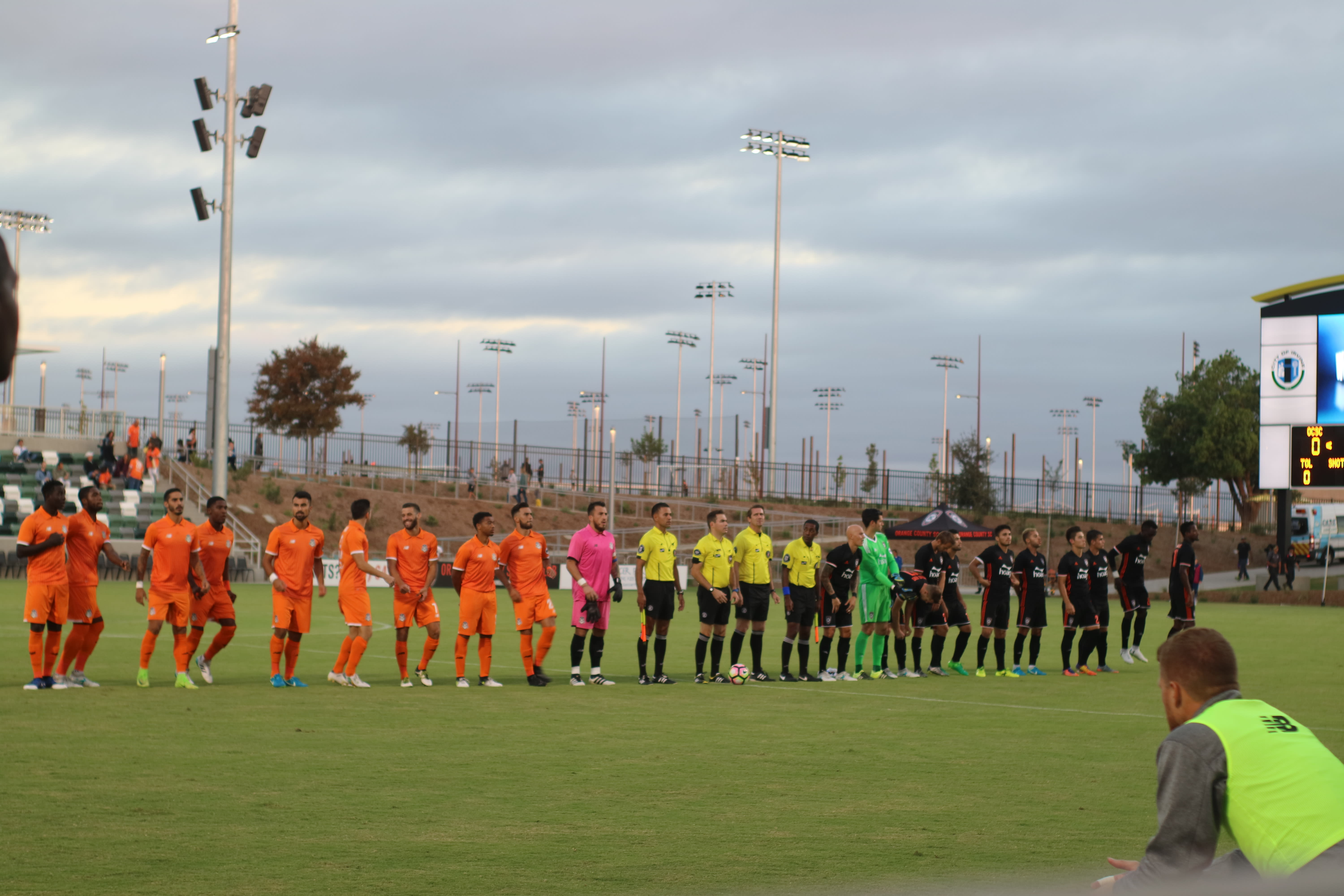 Soccer teams lined up on the Field