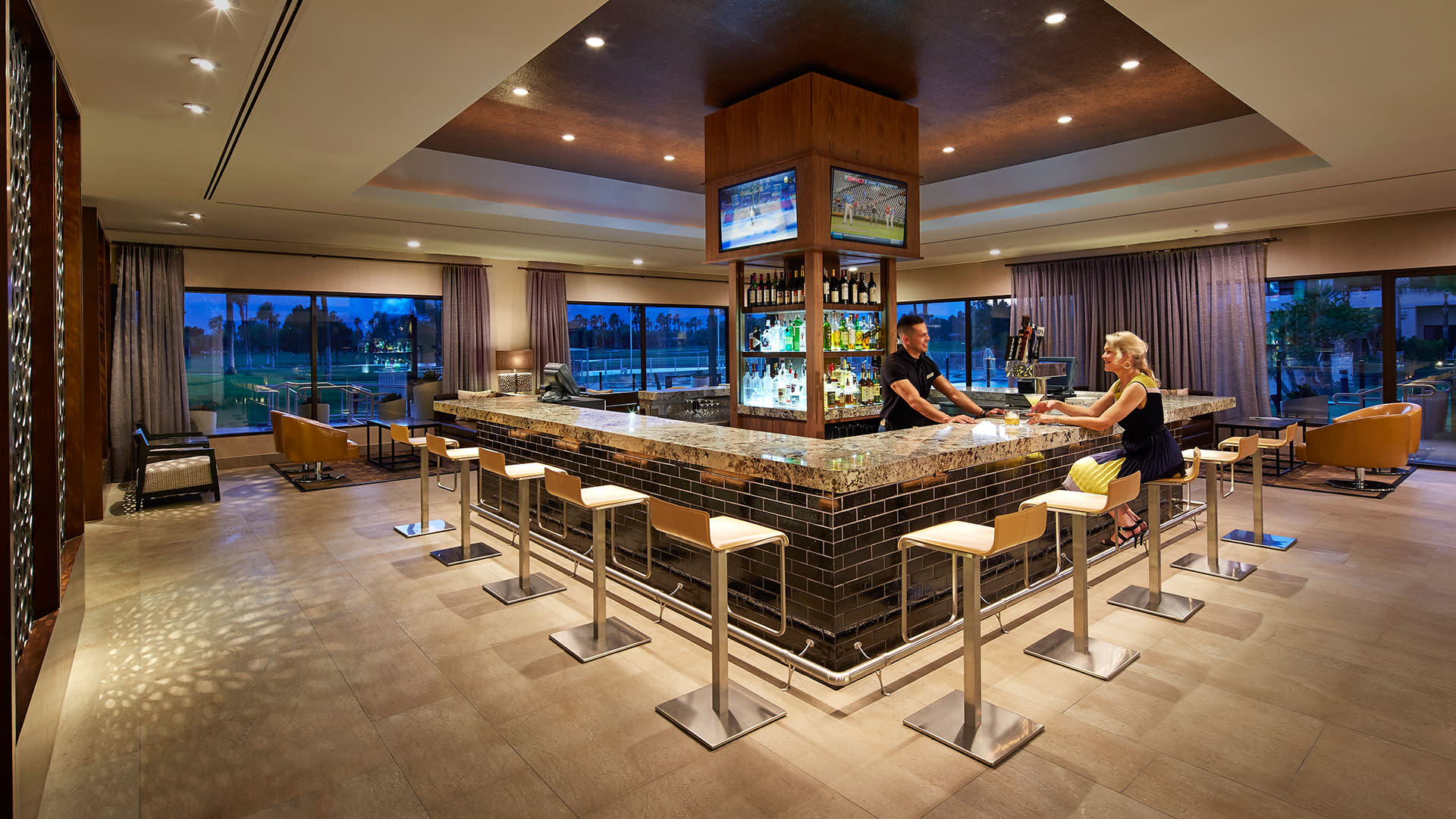 Sip a signature cocktail at Mira Bar at DoubleTree by Hilton Golf Resort Palm Springs