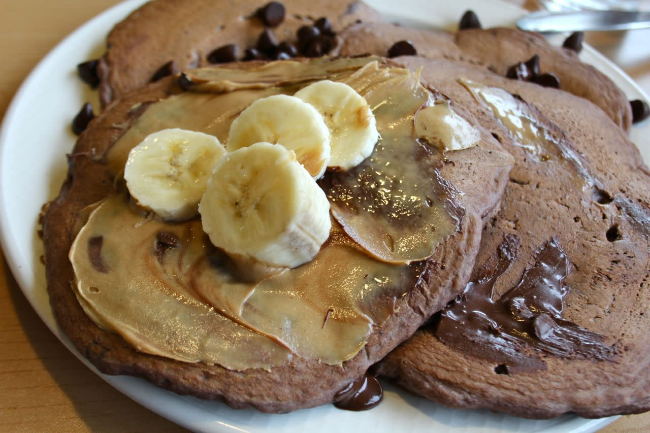 chocolate chocolate chip pancakes with peanut butter and banana