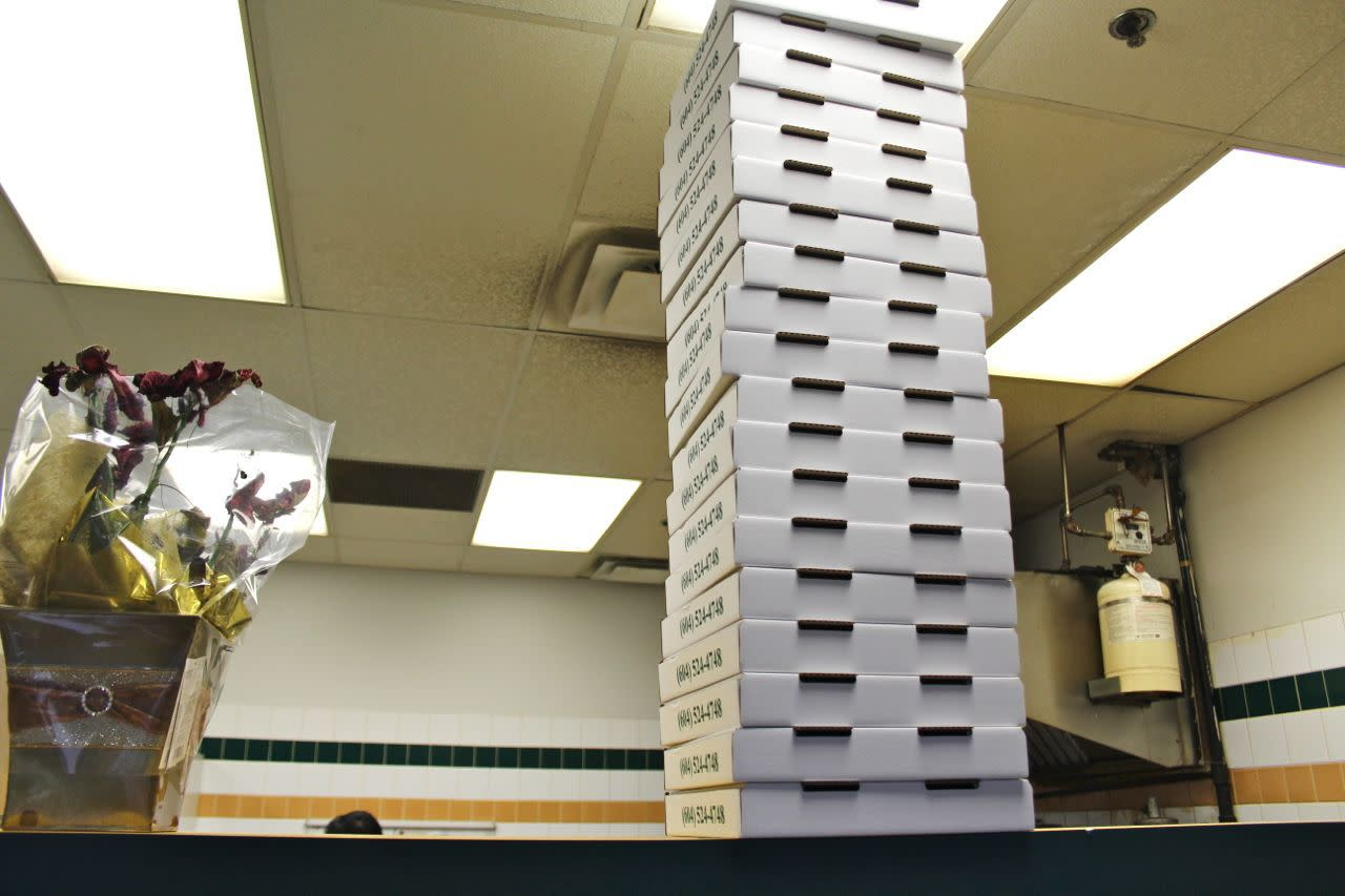 Pizza boxes at Paulo's Pizza