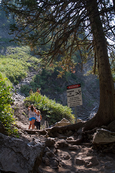 A sign warns hikers of the dangers of climbing