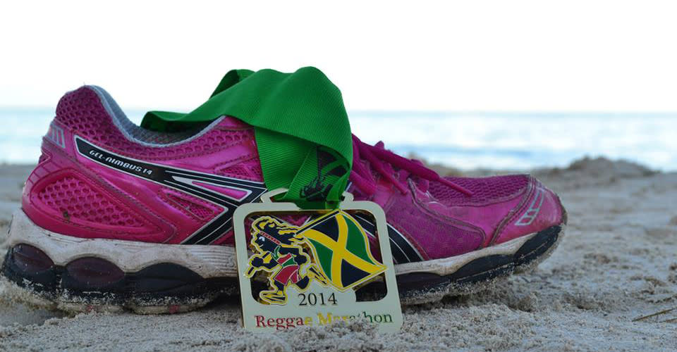 a photo of a running show on the beach of jamaica