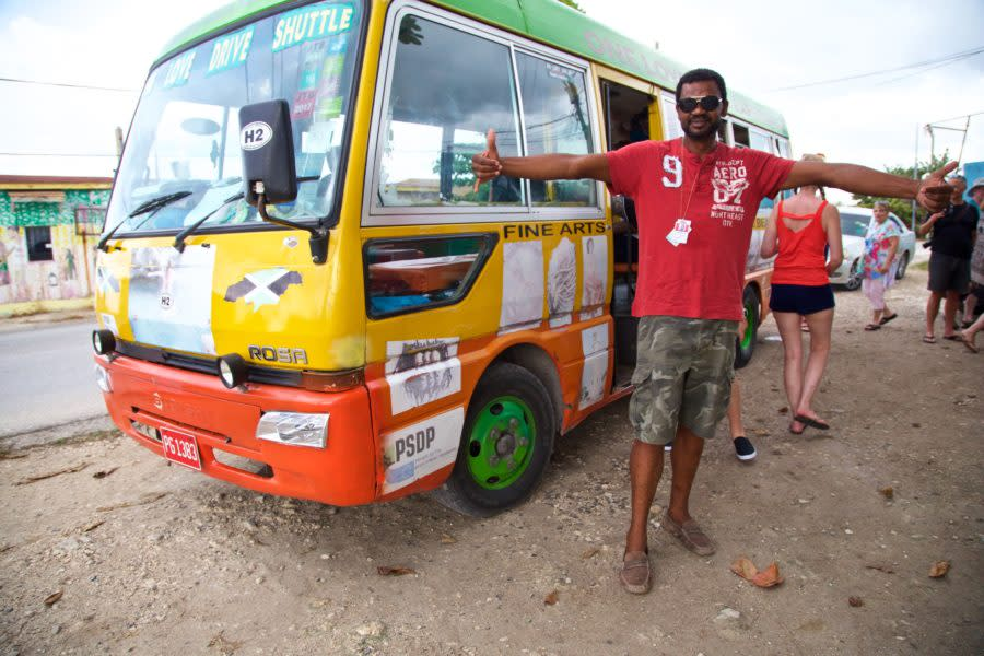 Lenbert Williams, host and driver of the One Love Bus Bar Crawl is all smiles at the first stop on the tour in Negril, Jamaica.