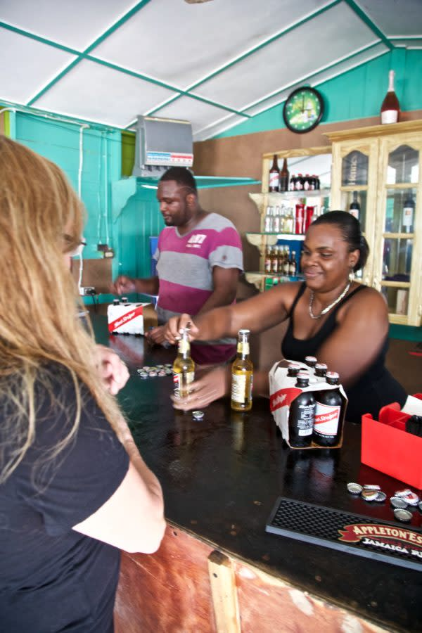Community tourism in action. One of the bars on the One Love Bus Bar Crawl in Negril, Jamaica. Red Stripe's are always on hand.