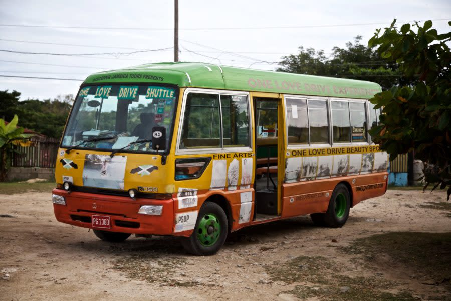 The bus! The famous One Love Bus awaits its passengers as part of the One Love Bus Bar Crawl in Negril, Jamaica. The bus has reportedly carried over 45,000 passengers as part of the community tourism initiative.
