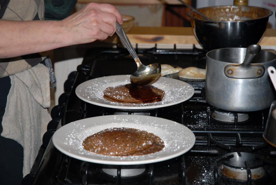 Chef Debbie Meritsky Ladling Syrup Over Beer Batter Pancakes