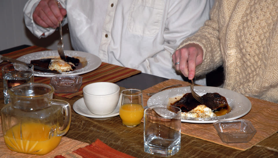 Couple Enjoying Beer Batter Pancakes with Ganache