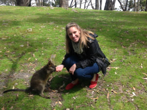Meaghan Frank poses with a wallaby in Australia where she recently received her MBA from the University of Adelaide.