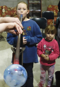 Children blowing glass at Hands-On Glass in Steuben