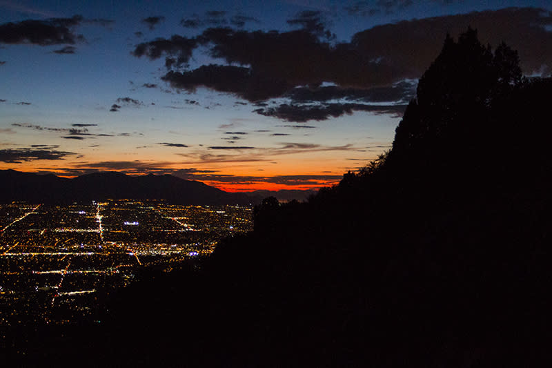 Salt Lake City lights from the trail on an evening descent