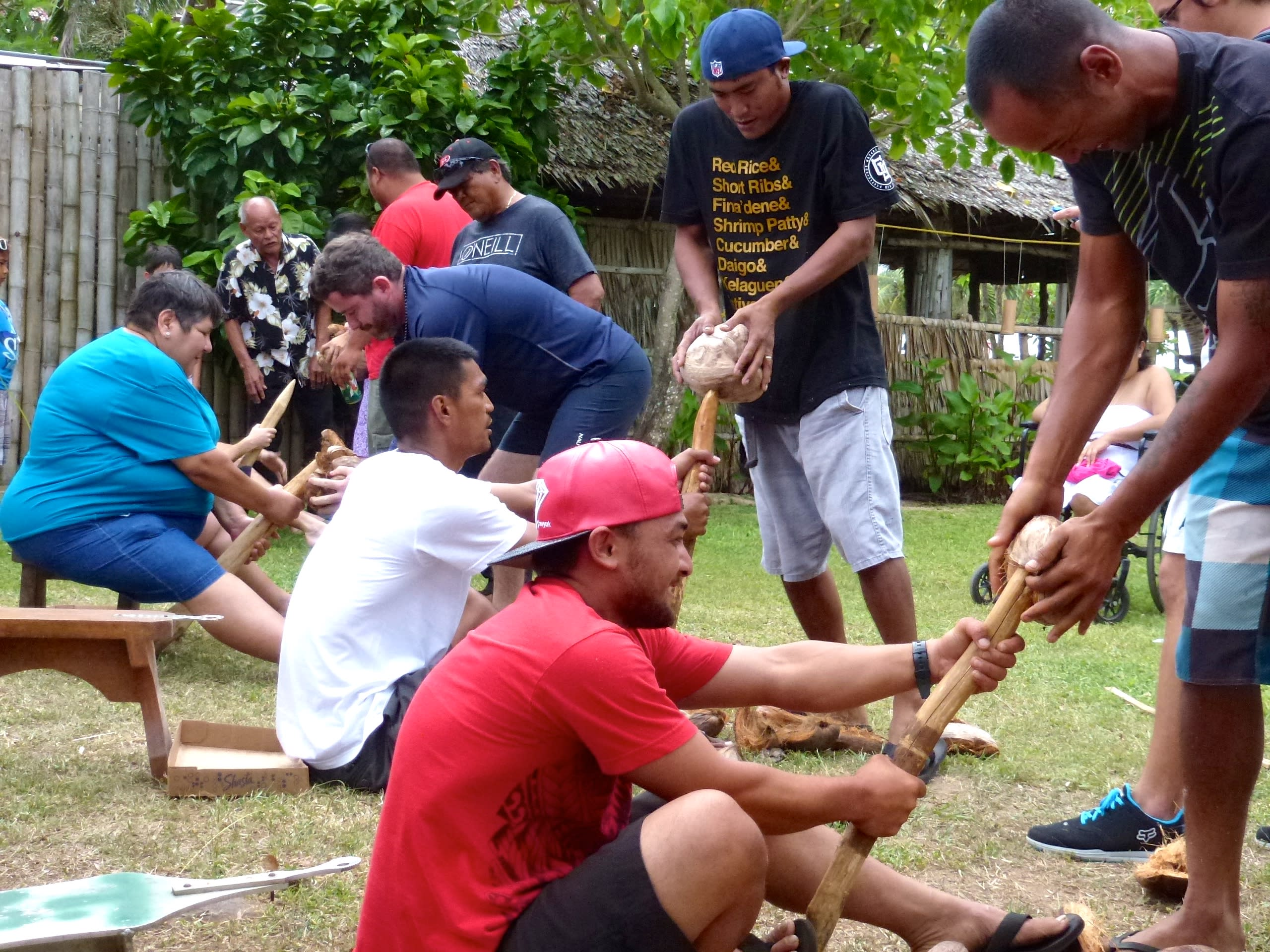 The coconut husking contest is one of many games held during the festival