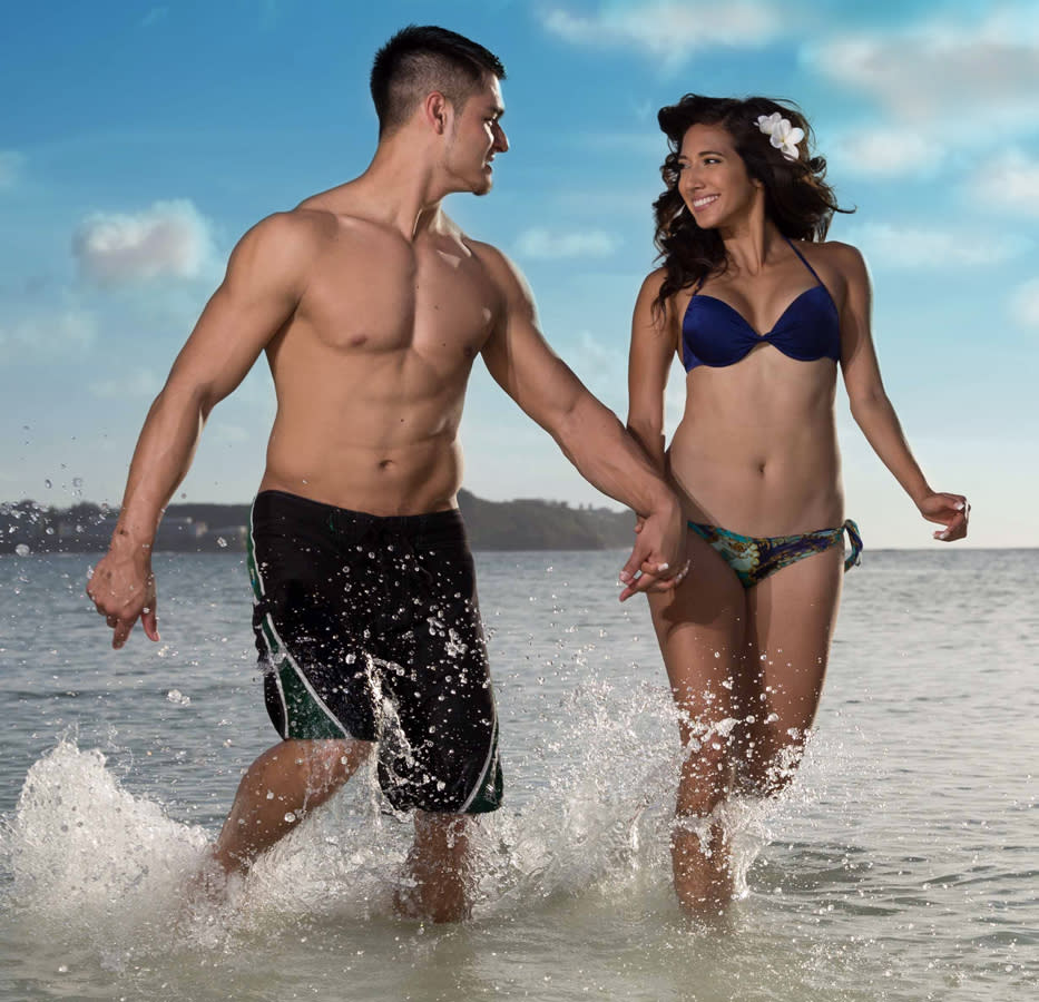 Couple splashing in the water