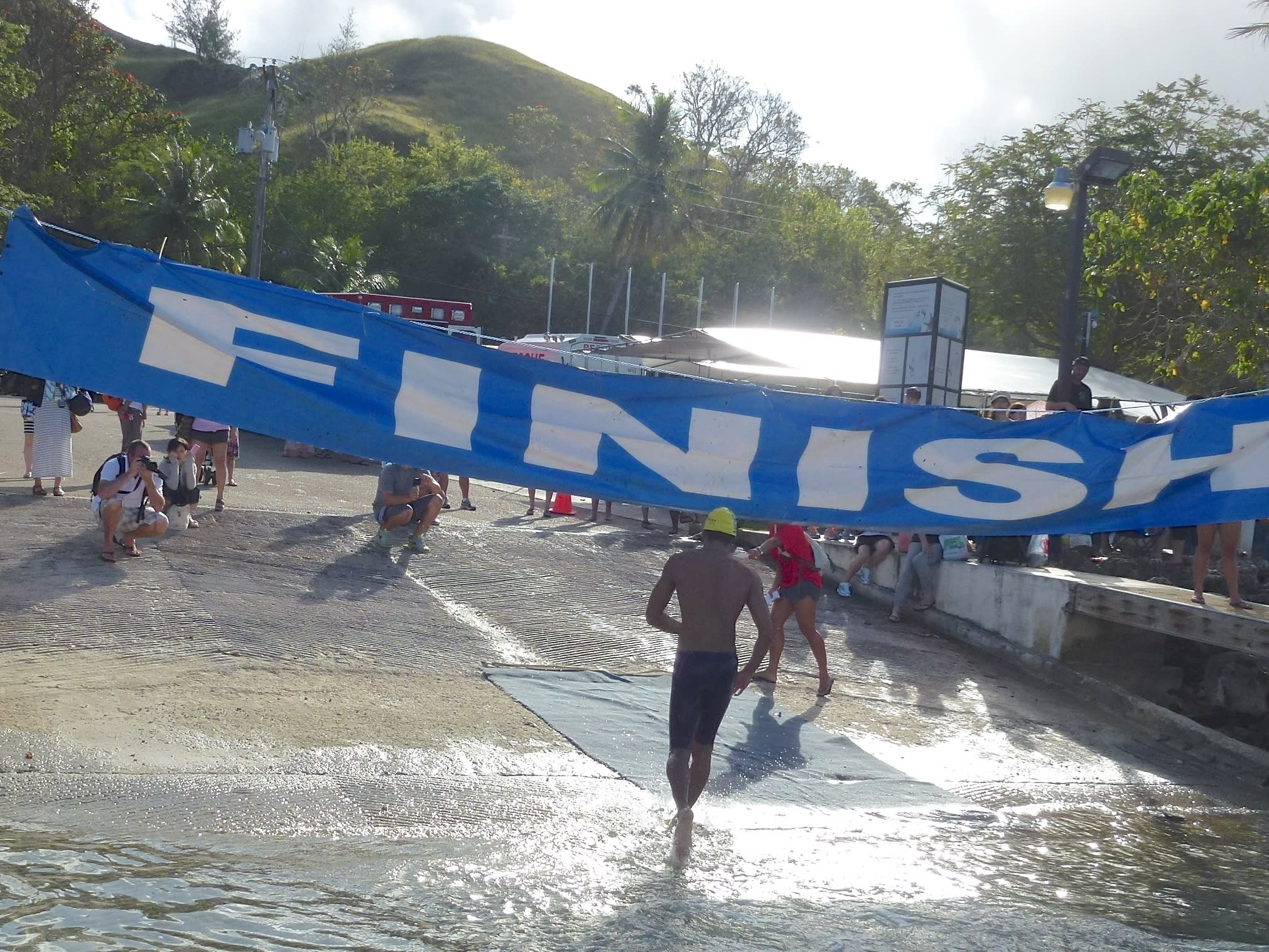 A swimmer crosses the finish line.