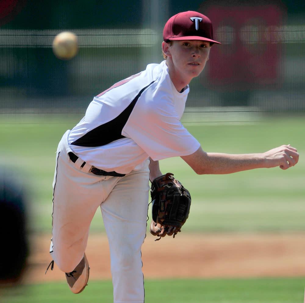 Teen Pitching Baseball