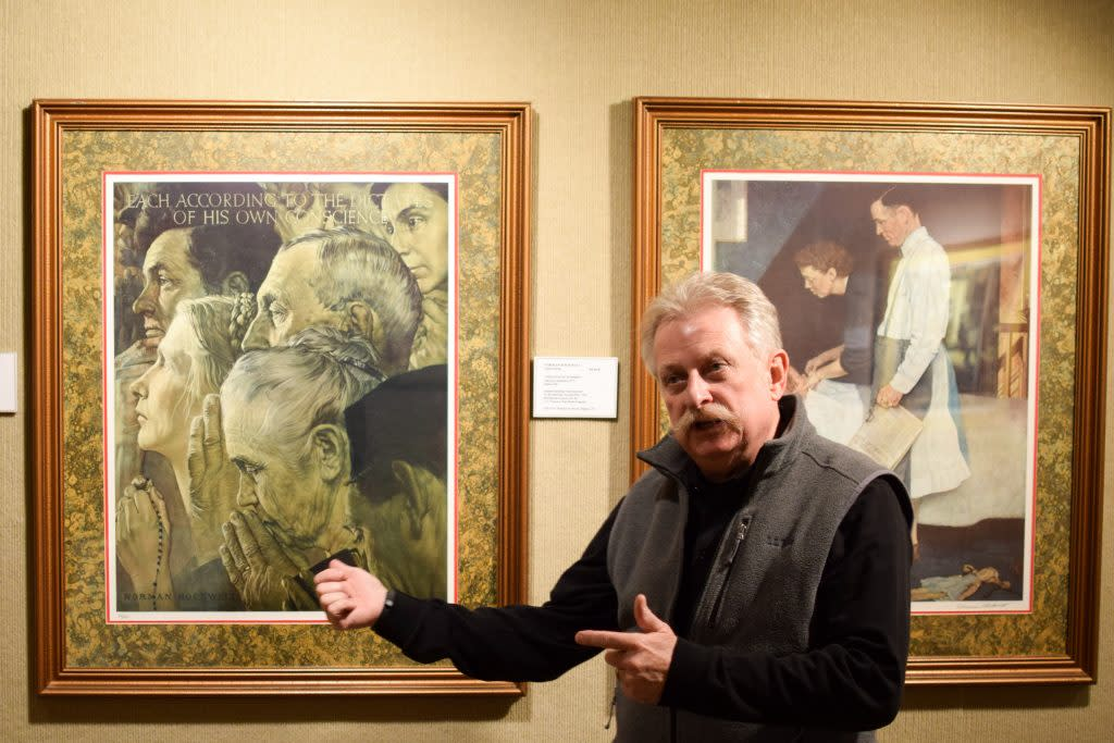 Brian Byrn explains the Norman Rockwell collection at the Midwest Museum of American Art. (Photo by Marshall V. King)