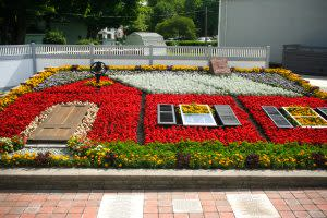 The Nappanee Center Quilt Garden often features decorative items to enhance the floral designs.
