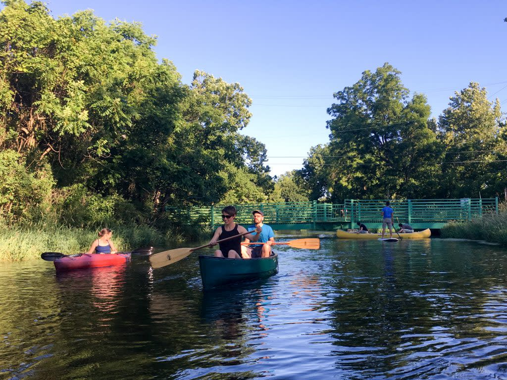 "Paddlers enjoy a ""full moon float"" trip down the Millrace Canal in Goshen. (Photo by Marshall V. King)"