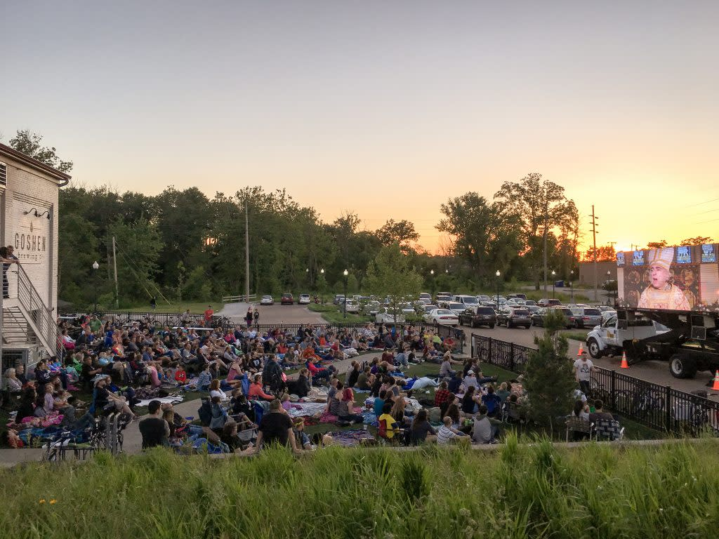 Hundreds gather to watch a movie outside Goshen Brewing Co. along the Millrace Canal. (Photo by Marshall V. King)