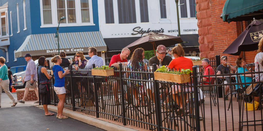 People enjoying the outdoor dining patio at The Vine in Elkhart County