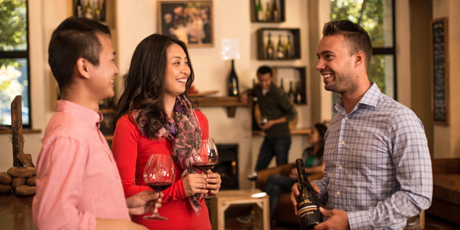 Tastes local wines from the cellar door Queenstown