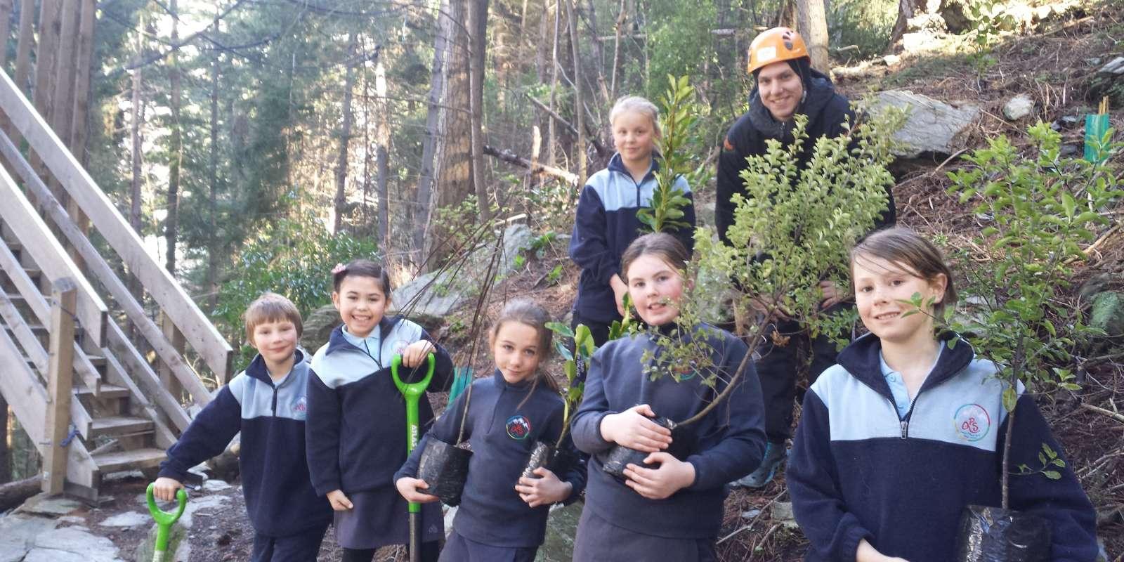 tree planting with Ziptrek and local schoolchildren