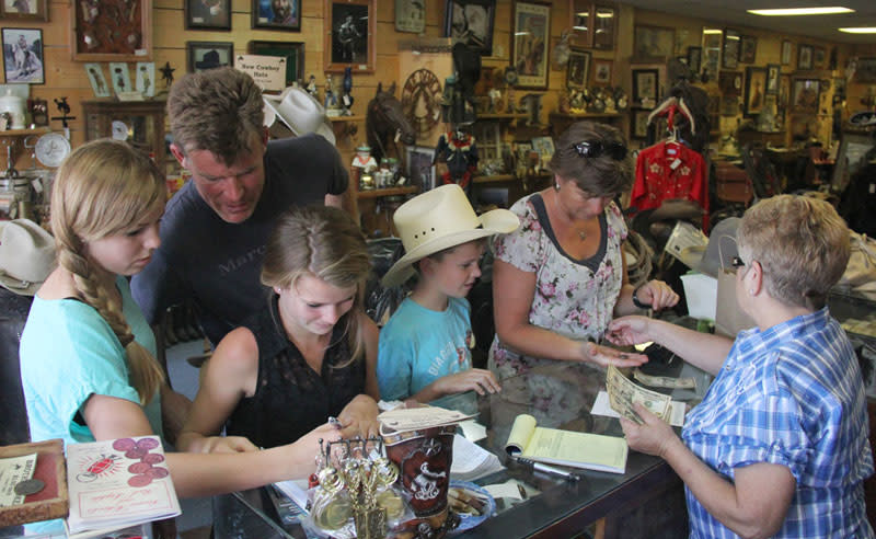A family from western Europe views western style items.
