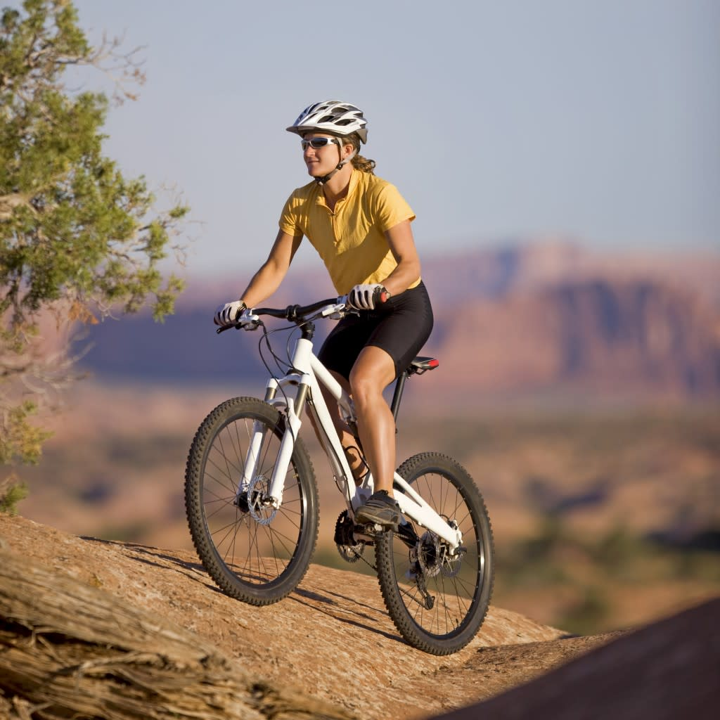 Mountain Biking On Rugged Terrain In Moab, Utah