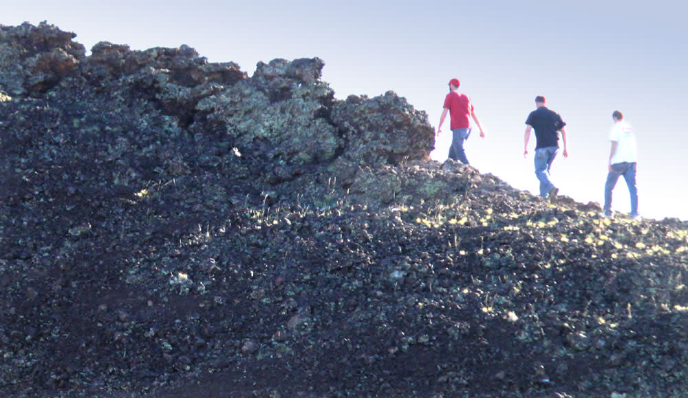 Hikers on Volcanic Rock