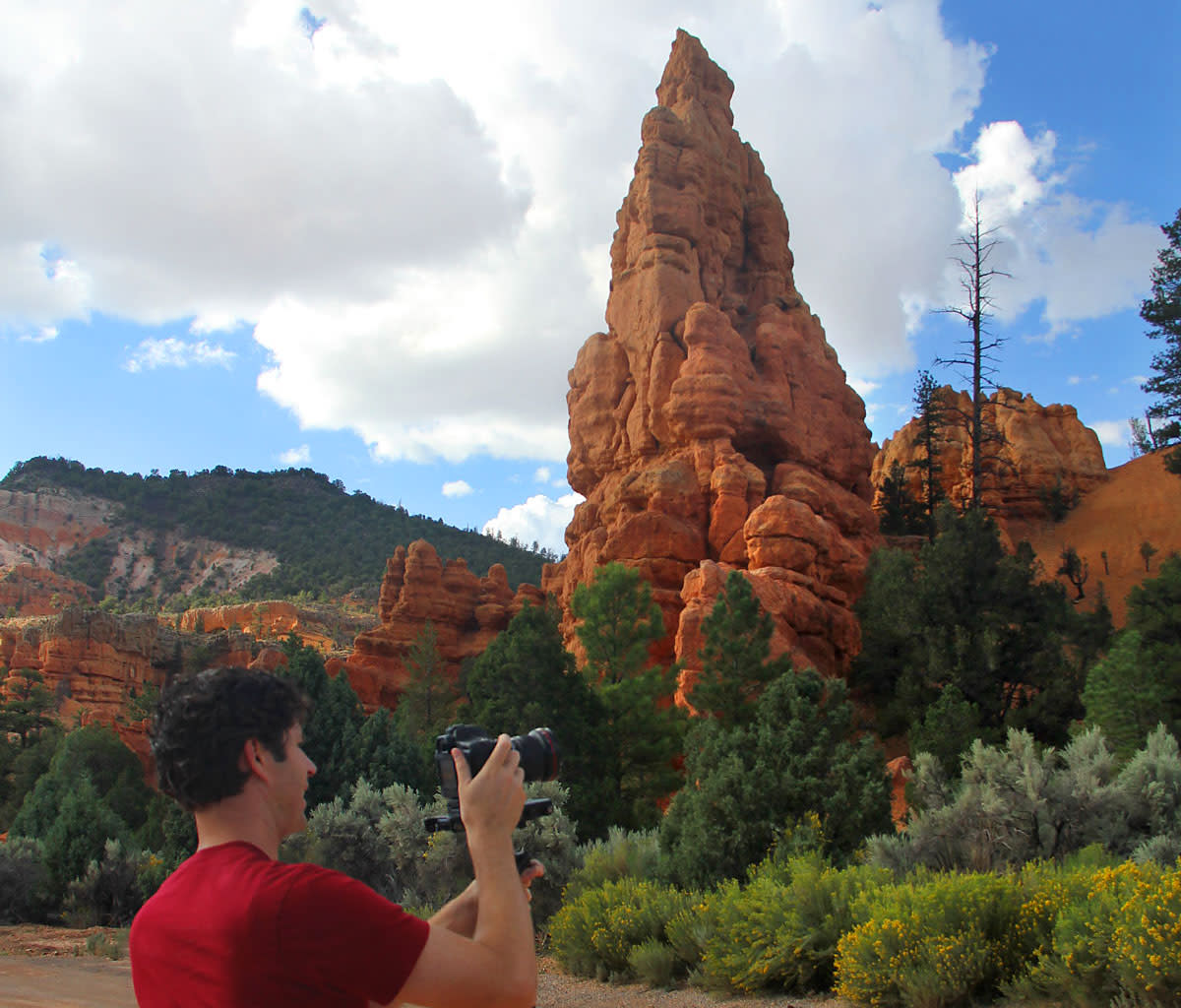A hiker takes photographs in Red Canyon, part of the Dixie National Forest.