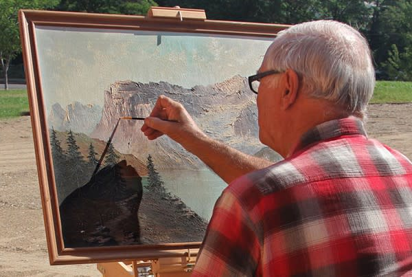 An artist works on an oil painting in Escalante, Utah.