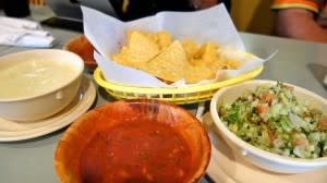 Chunky guacamole, queso sauce, salsa, and chips