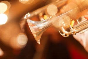 Detail of the trumpet closeup in golden tones