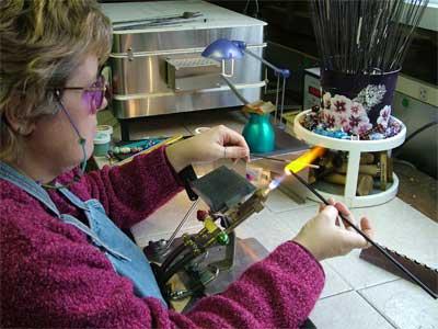 Making glass beads at Joyful Adornments.