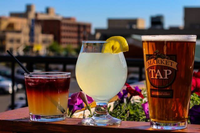 Image of three drinks in a line with a city skyline in the background. Click to go to Flint Farmers' Market webpage.