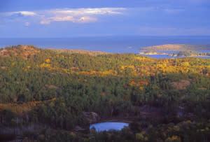 Fall color is seen on the landscape looking east toward Marquette from atop Hogback Mountain.