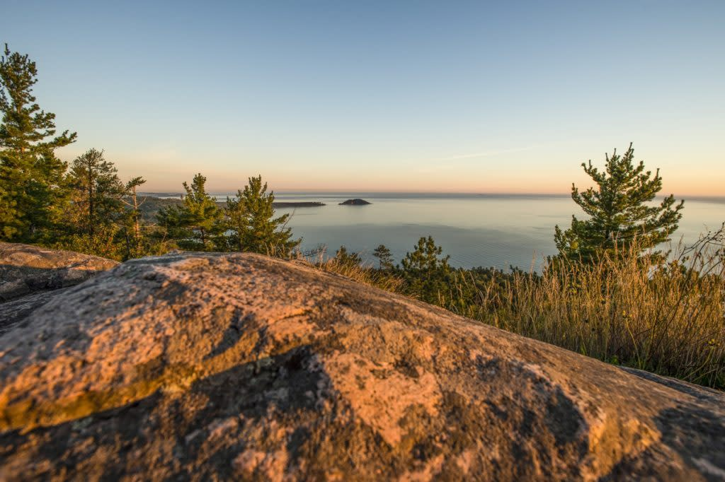 Dawn breaks over Lake Superior at Sugarloaf Mountain near Marquette, Michigan.