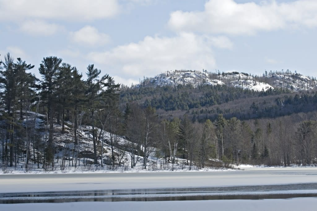 Frozen Harlow Lake and Hogback Mountain in the Escanaba River State Forest near Marquette Michigan Upper Peninsula.