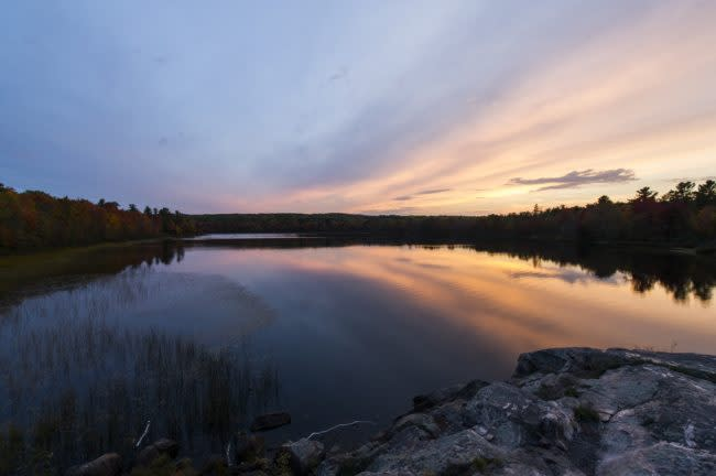 Dusk over Harlow Lake in autumn fall color near Marquette, Michigan on Michigan's Upper Peninsula.