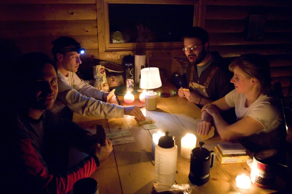 A group of friends play games while staying in a rustic cabin in Michigan's Upper Peninsula.