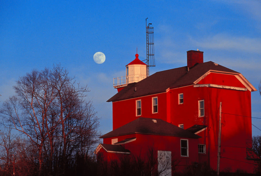MARQUETTE LIGHTHOUSE ON LAKE SUPERIOR WITH FULL MOON IN MARQUETTE, MICHIGAN.