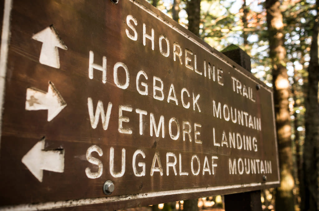 Trail sign for Hogback Mountain, Wetmore Landing and Sugarloaf Mountain along the Shoreline Trail and North Country Trail near Marquette, Michigan.