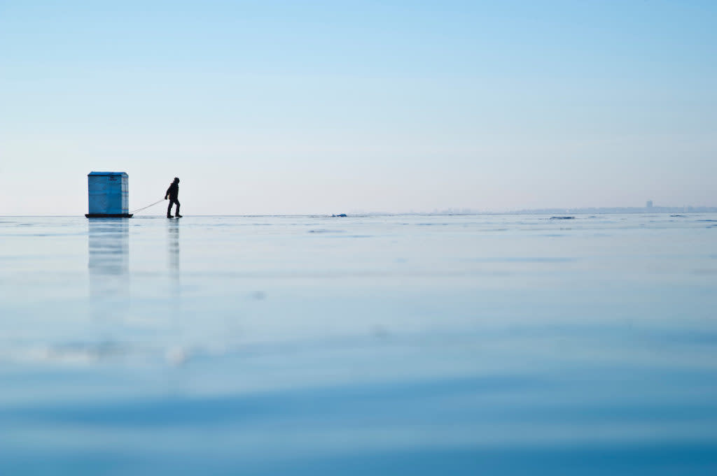 Ice fishing on frozen Little Bay de Noc on Lake Michigan in Gladstone Escanaba Michigan's Upper Peninsula.