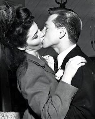 Ava and Mickey Rooney kissing wedding day