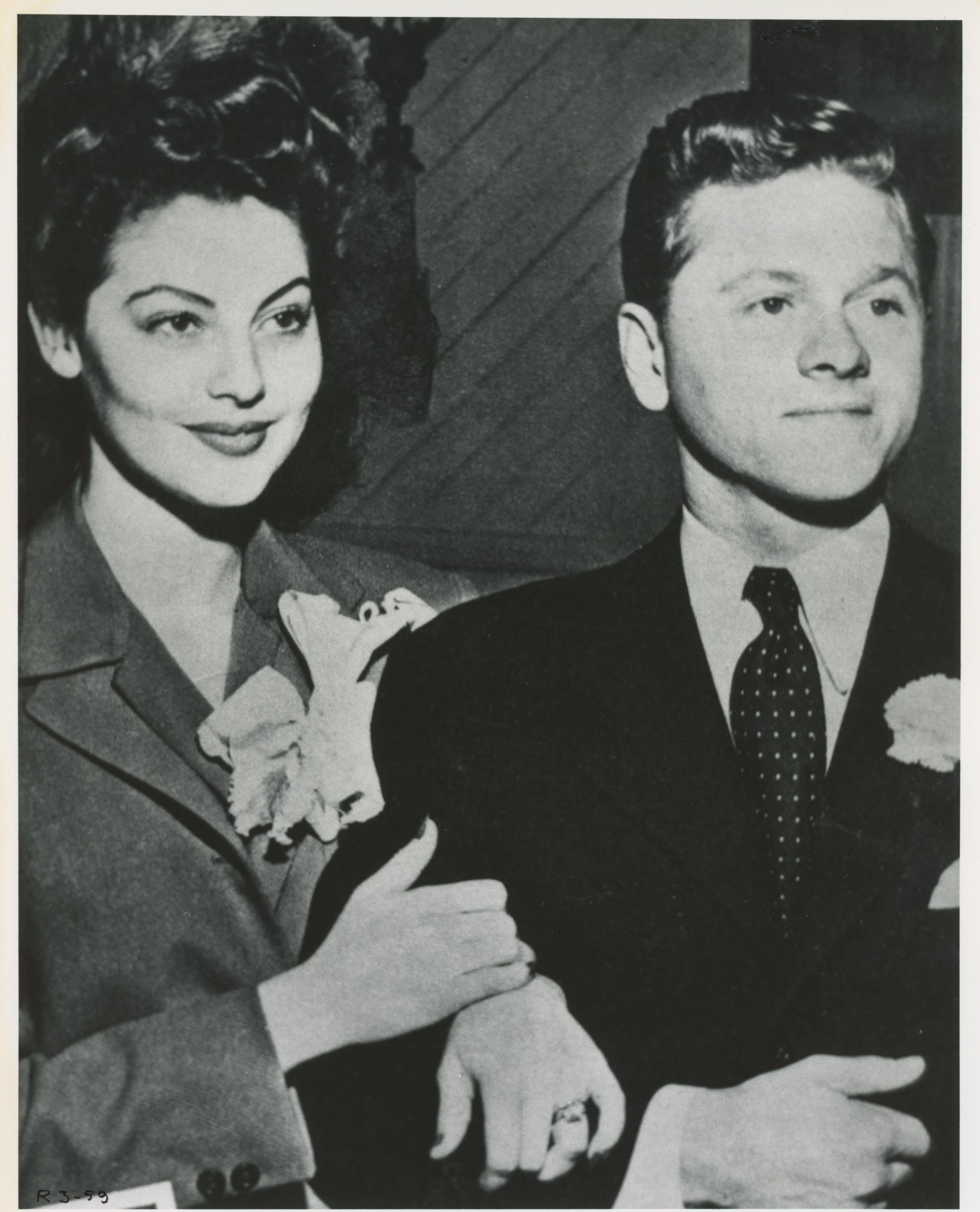 Ava and Mickey's Wedding; Newlyweds clutching each other
